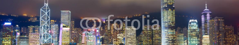 44313351 – Hong-Kong – Hong Kong skyline at mist over Victoria harbor
