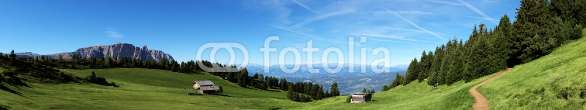 56742738 – Italy – Mountain panorama with chalet and pastures