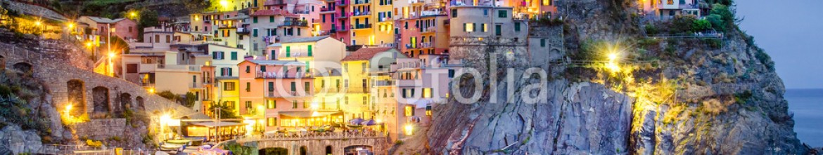 56857758 – Italy – Scenic night view of colorful village Manarola in Cinque Terre