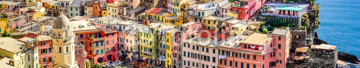 56857806 – Italy – Scenic view of ocean and harbor in colorful village Vernazza