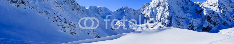 57430412 – Poland – Winter mountains, panorama of the Italian Alps
