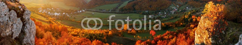 57678447 – Slovakia – Autumn panorama with sun and forest, Slovakia