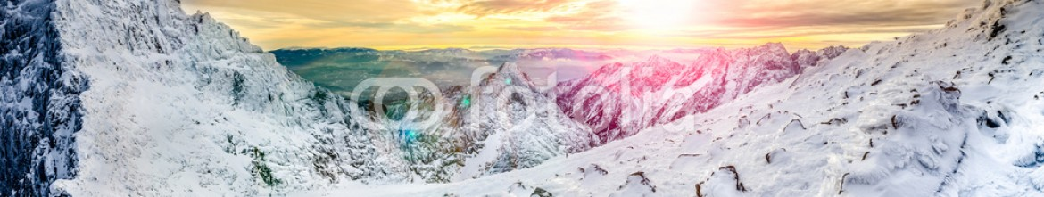 60096237 – Slovakia – Panoramic view of white winter mountains at colorful sunset