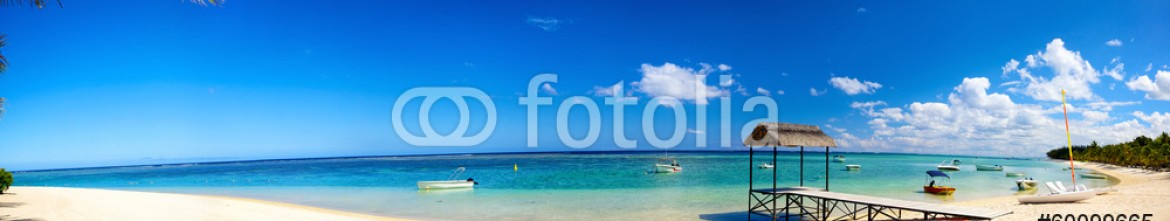 60099665 – Mauritius – Panoramic view of tropical beach with jetty and boats