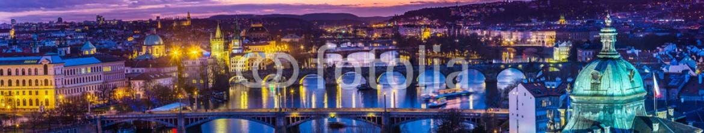 60176684 – Ukraine – Bridges in Prague over the river at sunset