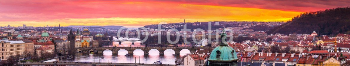 60176705 – Ukraine – Bridges in Prague over the river at sunset