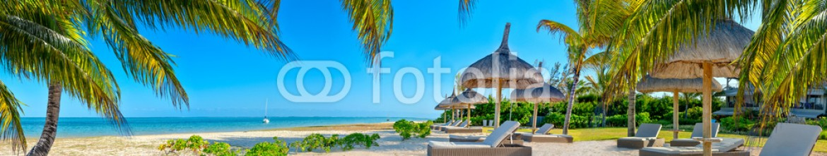 62528525 – Italy – Paradise beach with palms and parasol