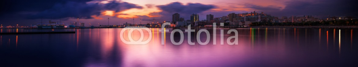 64299888 – Italy – Cityscape sunset with reflection in the sea