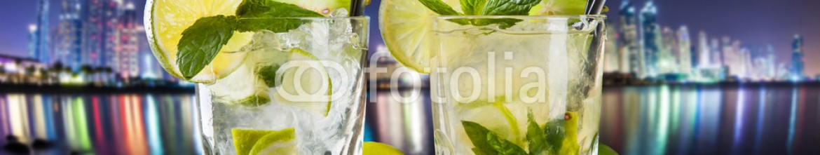 64569742 – Czech Republic – Summer mojito drinks at night city