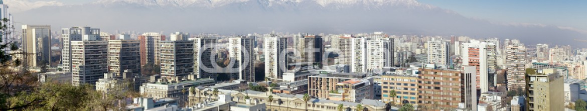 64700761 – Canada – Aerial view of a city and The Andes mountain in the background,