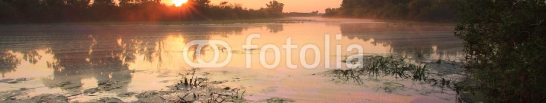 67054969 – Ukraine – Sunrise over the lake with reflection