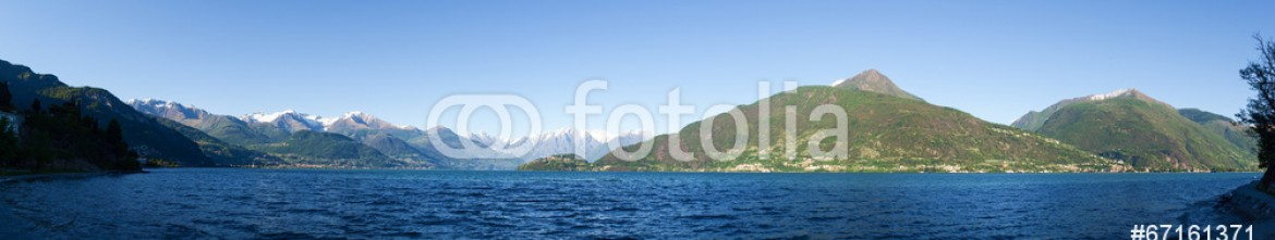 67161371 – Italy – Panorama of the Lake of Como from the Beach at evening sunlight