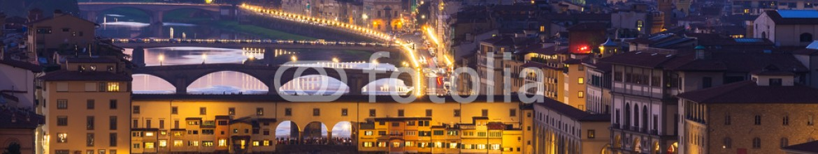 71115874 – Russian Federation – Night view of Ponte Vecchio over Arno River in Florence, Italy