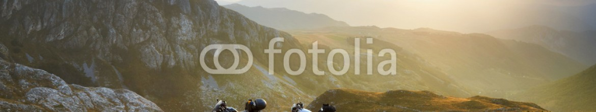 73463758 – Ukraine – Landscape with mountain road and two motorbikes