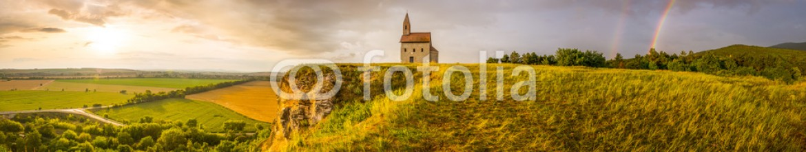 74153522 – Slovakia – Old Roman Church at Sunset in Drazovce, Slovakia