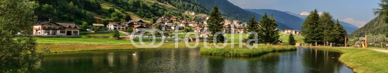 74342725 – Italy – Trentino – park with small lake in Vermiglio