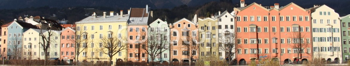 75202546 – Austria – Houses alongside River Inn in Innsbruck, Austria