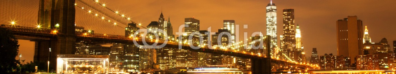 75963012 – Czech Republic – New York City Manhattan Downtown with Brooklyn Bridge at dusk