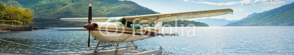 76841792 – Italy – Float plane moored at a beach on Lake Como in Italy, Europe