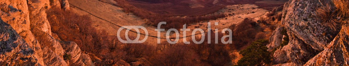 77896991 – Ukraine – aerial view of mountain hills and sunrise above the sea