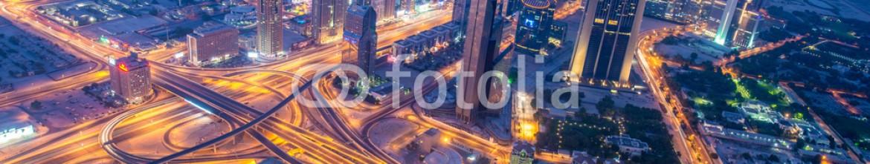80330906 – Azerbaijan – Panorama of night Dubai during sunset