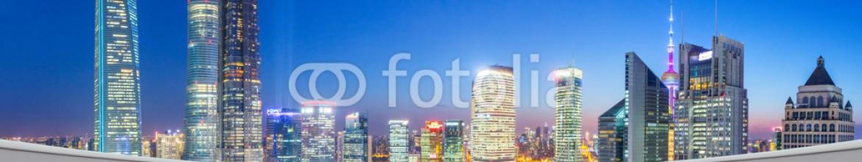 80976543 – China – futuristic office with modern skyline