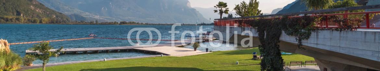 81584593 – Russian Federation – lake garden mountains view