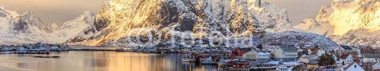 82259720 – Ukraine – Fjord and red rorbu at sunset in Lofoten