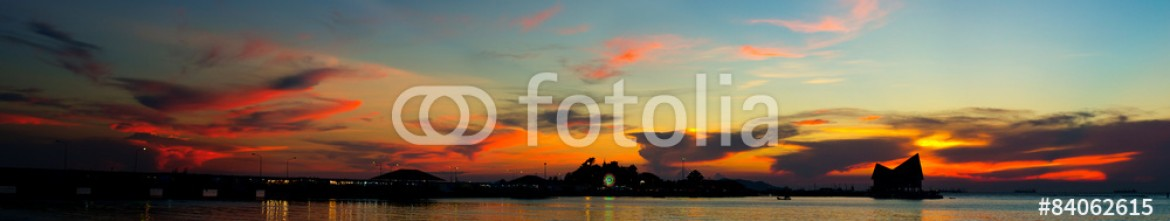 84062615 – Thailand – Panoramic sunset sky with silhouette of island (Kho Loi), Landsc