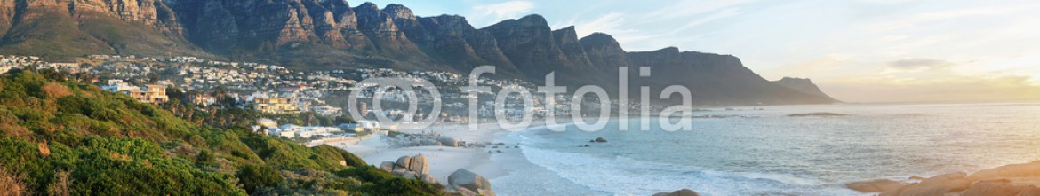 85267599 – Spain – Camps Bay Beach in Cape Town, South Africa, with the Twelve Apostles in the background.