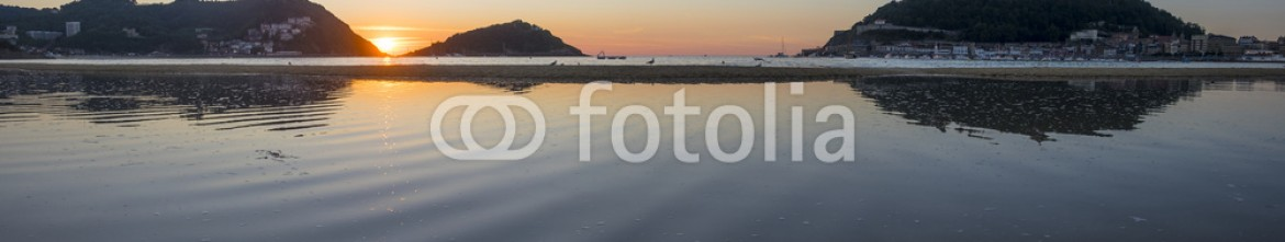 85944733 – Spain – Summer sun sunset on the beach of La Concha in the city of Donostia