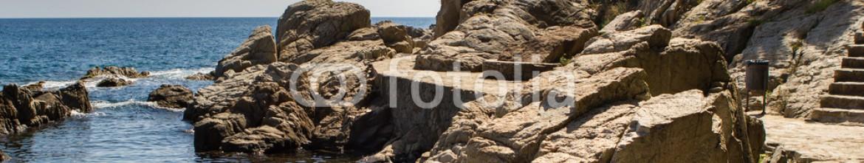 86556287 – Spain – Pretty rocks and sea on costa brava in Spain