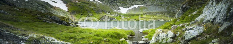87584584 – Romania – Misty mountain and lake