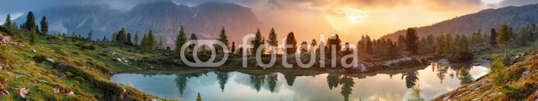 87811647 – Italy – Mountain alps lake sunset panorama in Dolomites