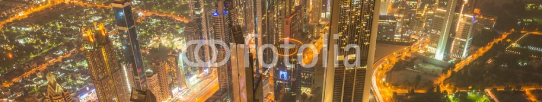 87948574 – Azerbaijan – Panorama of night Dubai during sunset