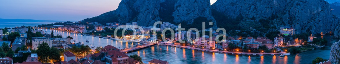 88259907 – Croatia – Panorama city Omis lit at sunset (from Mirabella tower)