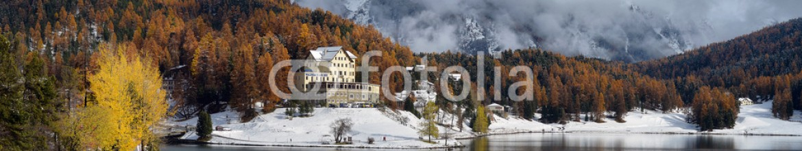 88276612 – Ukraine – Lake St. Moritz with the first snow in the autumn