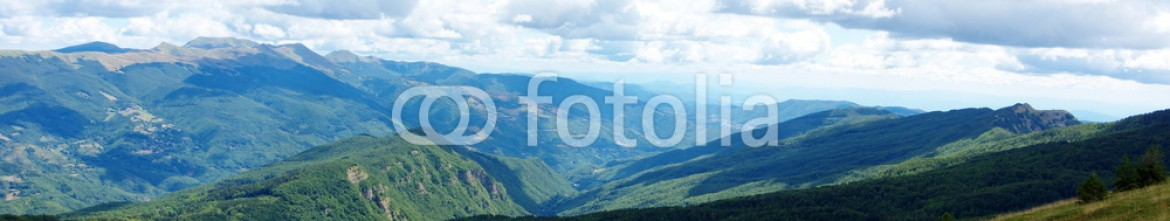 89768798 – Italy – Mountain landscape panorama of Abetone, Tuscany, Italy from above. Valle del Sestaione under a beautiful cloudy sky.