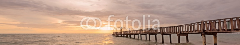 90772178 – Thailand – Wooden bridge  along sunrise sky