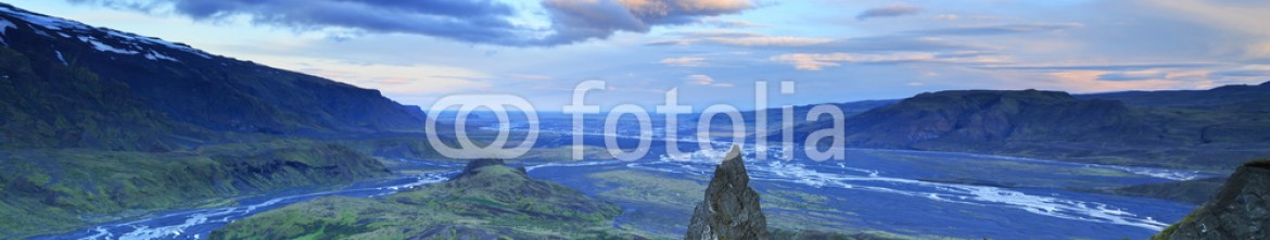 91153898 – Iceland – Dramatic clouds during a sunrise on a mountaintop in the highlands of Iceland.