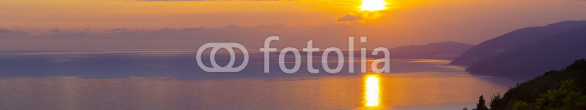 92599524 – Russian Federation – Sunset with sea and mountains