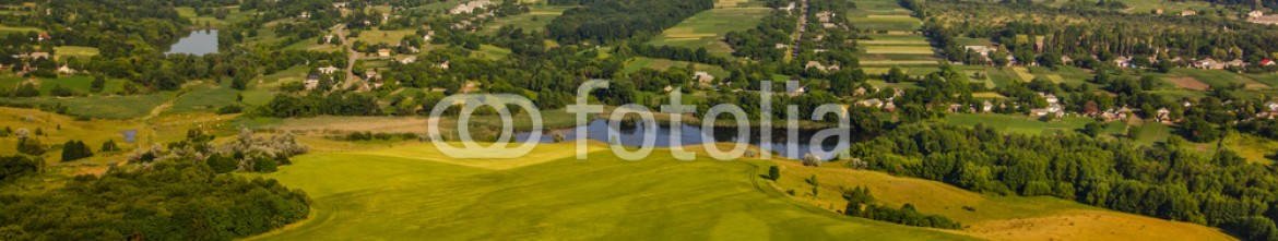 93109911 – Ukraine – aerial view above the village and green fields