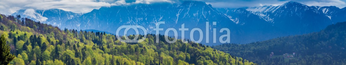 93148691 – Romania – Romania, Predeal. Panorama with the snowy peaks of the Bucegi mountains and the green forests of Predeal,  in springtime, when the nature comes back to life and the snow starts to melt
