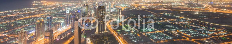 93381288 – Azerbaijan – Panorama of night Dubai during sunset